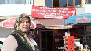 HAYIRSEVER HERKESİN BAKKAL BORCUNU KAPATTI...